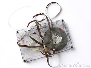 old-damaged-cassette-tape-12178544